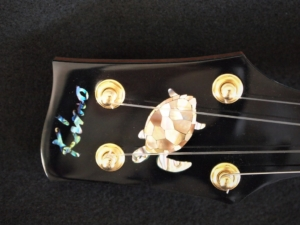 honu tenor ukulele with larry robinson honu inlay in bronze mother of pearl by kimo ukulele san diego ca