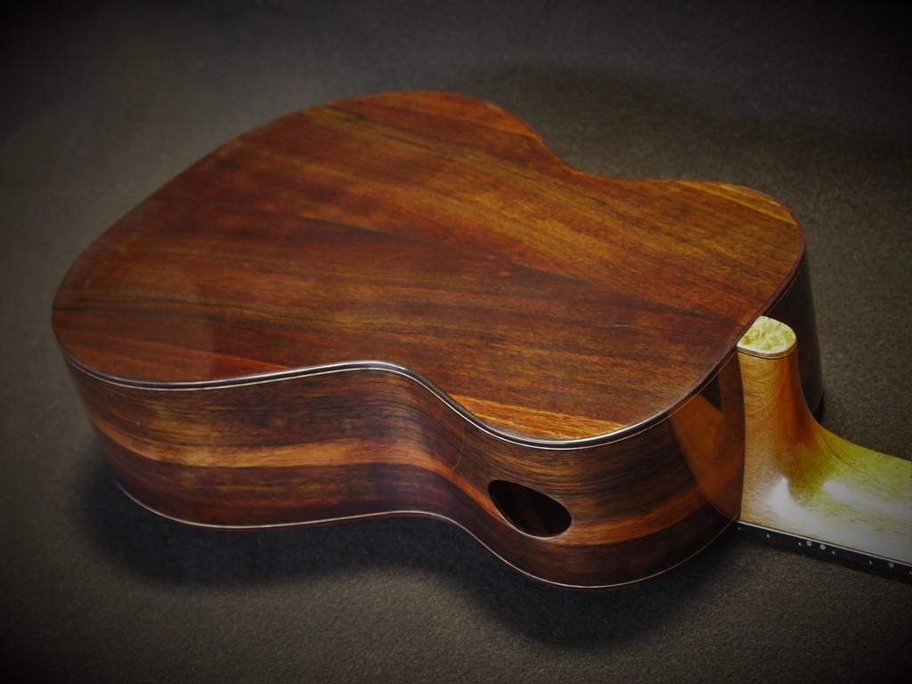 six string redwood baritone ukulele.