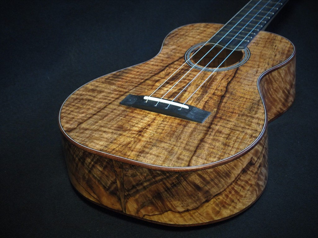 curly mango baritone please